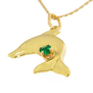 Photo of a gold dolphin pendant