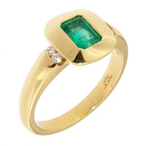 photo of a gold ring with emerald and diamonds