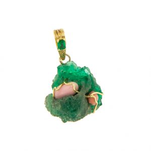 photo of an emerald and conch pearl pendant