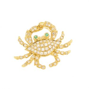 photo of a gold crab pendant with diamonds and emeralds