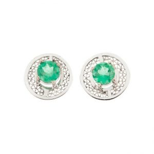 photo of white gold earrings with emeralds