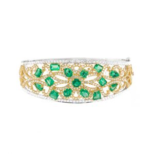 photo of a gold and white gold bracelet with emeralds and diamonds