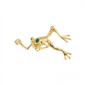 photo of a gold frog pendant with emeralds