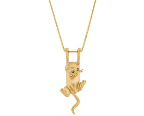 gold cat pendant with emerald eyes on gold chain