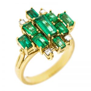 mdg ring with 9 emeralds and 4 diamonds
