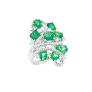 assorted cut emerald and diamond ring in white and yellow gold