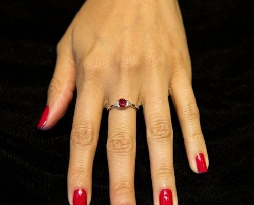 red beryl and diamond ring set in white and yellow gold on model
