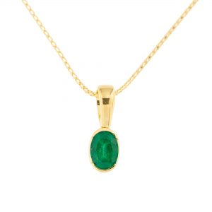 oval cut small emerald pendant in yellow gold