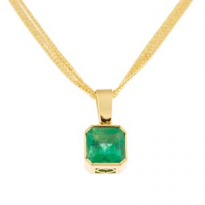 large square cut emerald pendant in yellow gold