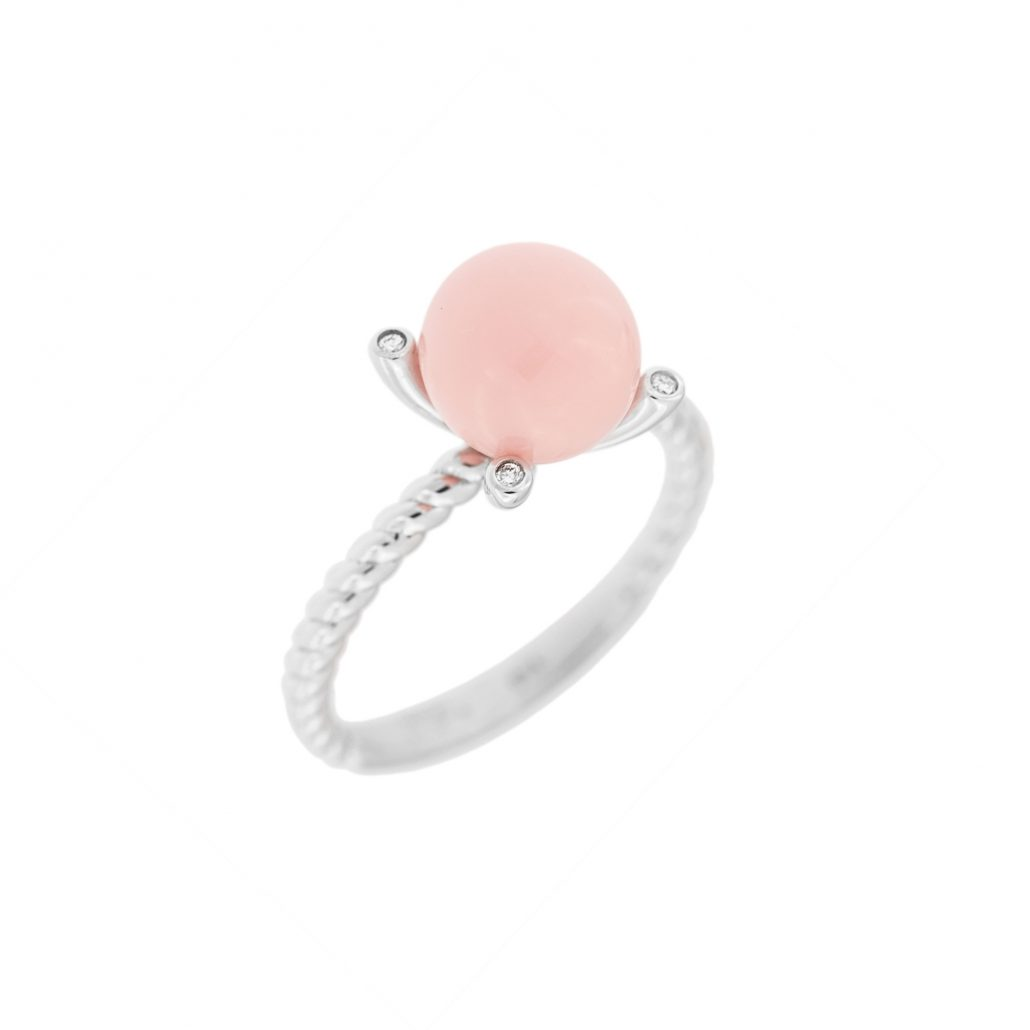 conch pearl ring with 4 round diamonds in white gold