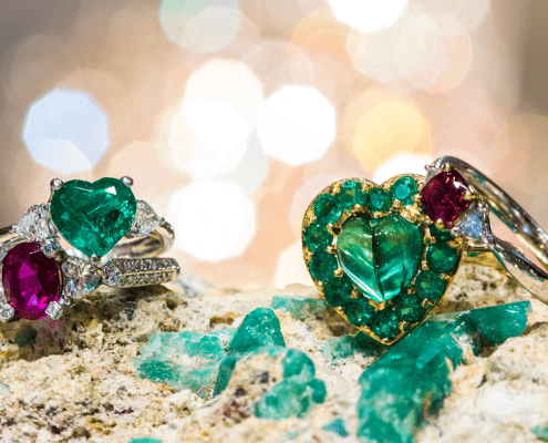 heart emeralds, ruby and red beryl, and diamond rings by Marcial de Gomar of Emeralds International LLC. jewelers key west FL