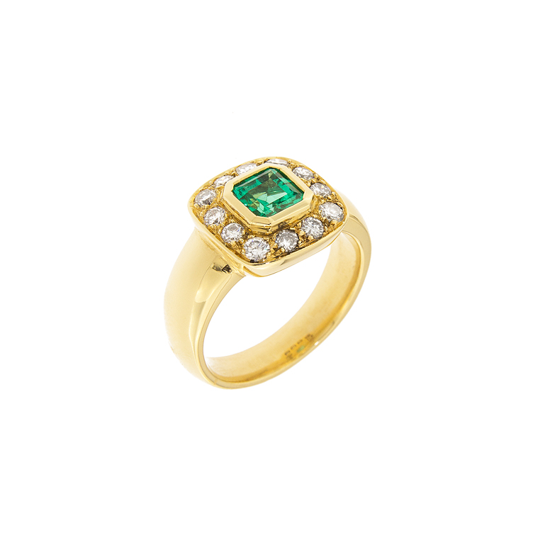 photo of a gold ring with emerald and diamond