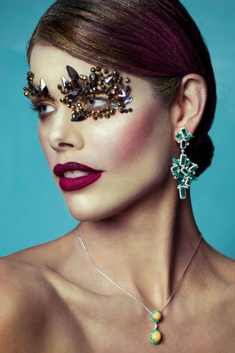 Photo of Golden Delight, a conch pearl and emerald pendant by Marcial de Gomar, on a model.