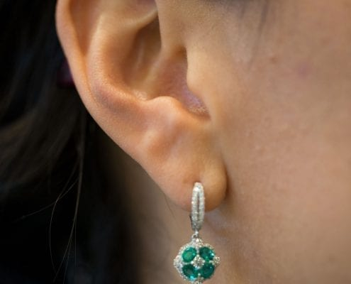 emerald and diamond earrings in white gold on model