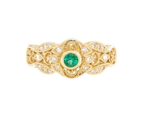 fancy emerald and diamond ring in yellow gold