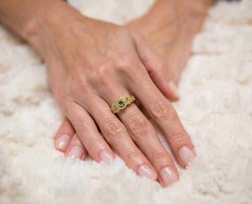 fancy emerald and diamond ring in yellow gold on model
