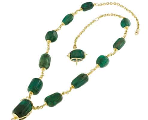 Emerald Planets Necklace shown on an angle