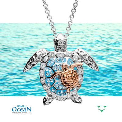 Mom & Baby Turtle Pendant with ocean background.