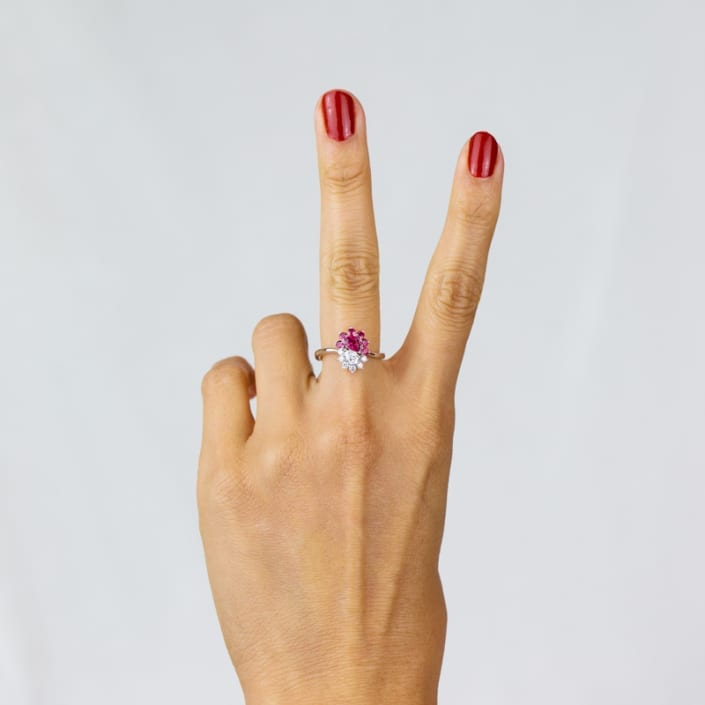 Photo of the Equality Ring on a models hand showing the peace symbol.