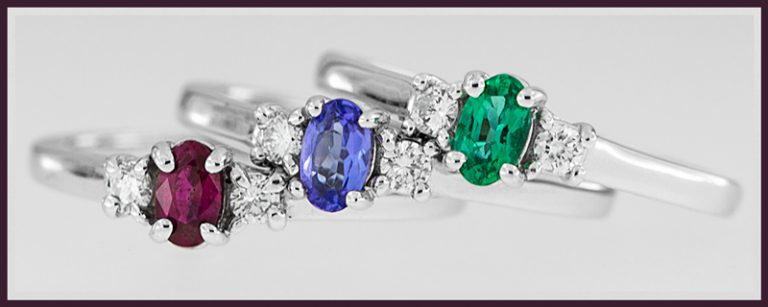 Ruby, Tanzanite, and Emerald Rings together.